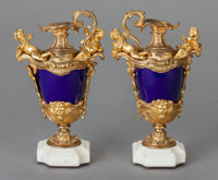 A PAIR OF NAPOLEON III-STYLE COBALT BLUE PORCELAIN AND GILT BRONZE EWERS ON MARBLE BASES, 20th century 7-3/4 inche
