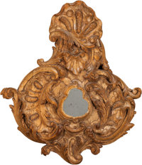AN ITALIAN ROCOCO-STYLE CARVED WALNUT MIRROR, late 19th century 31-1/4 inches high x 27 inches wide (79.4 x 68.6 c