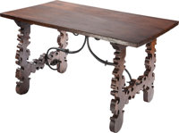 AN ITALIAN BAROQUE-STYLE WALNUT AND WROUGHT IRON TRESTLE TABLE, 19th/20th centuries 30-1/2 x 52-1/2 x 30-1/2 inche