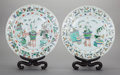 Asian:Chinese, A PAIR OF CHINESE FAMILLE VERTE PORCELAIN CHARGERS WITH WOODSTANDS, Kangxi Period with later stands. Marks: (Mandarin mark ...(Total: 2 Items)