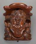 Decorative Arts, Continental:Other , AN ITALIAN BAROQUE-STYLE CARVED WALNUT CHERUB MOUNTED AS A SHELF,19th century and later. 18 x 19-1/4 x 13-3/4 inches (45.7 ...
