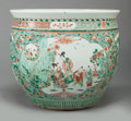 Asian:Chinese, A CHINESE FAMILLE VERTE PORCELAIN JARDINIÈRE, late 19th/early 20thcentury. 15-3/4 inches high x 18-1/2 inches wide (40.0 x ...