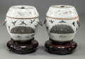 Asian:Chinese, A PAIR OF SMALL CHINESE FAMILLE ROSE PORCELAIN COVERED FOOD JARS ONCARVED WOOD STANDS, 19th century. 7-1/2 inches high (19.... (Total:2 Items)
