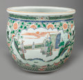 Asian:Chinese, A CHINESE FAMILLE VERTE PORCELAIN JARDINIÈRE, late 19th/early 20thcentury. 16-1/2 inches high x 18-1/4 inches wide (41.9 x ...
