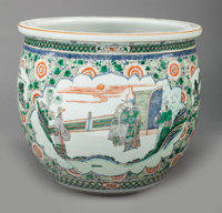 A CHINESE FAMILLE VERTE PORCELAIN JARDINIÈRE, late 19th/early 20th century 16-1/2 inches high x 18-1/4 inches wid...
