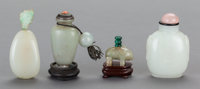 THREE CHINESE CELADON JADE SNUFF BOTTLES AND A GLASS SNUFF BOTTLE 3 inches high (7.6 cm) (tallest)
