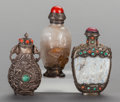 Asian:Chinese, A GROUP OF THREE CHINESE SILVER AND SILVER MOUNTED SNUFF BOTTLES.3-7/8 inches high (9.8 cm) (tallest). ... (Total: 3 Items)