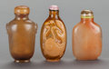 Asian:Chinese, A GROUP OF THREE CHINESE HARDSTONE SNUFF BOTTLES. 3 inches high(7.6 cm). ... (Total: 3 Items)