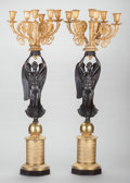 Decorative Arts, French:Lamps & Lighting, A PAIR OF NEOCLASSICAL-STYLE GILT AND PATINATED BRONZE FIGURALSIX-LIGHT CANDELABRA, circa 1900. 29-1/2 inches tall (74.9 cm...(Total: 2 Items)