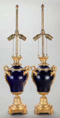 Decorative Arts, French:Lamps & Lighting, A PAIR OF COBALT BLUE PORCELAIN AND GILT BRONZE MOUNTED URN LAMPBASES, 20th century. 32 inches high (81.3 cm) (overall). ...(Total: 2 Items)