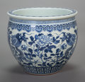 Asian:Chinese, A CHINESE PORCELAIN JARDINIÈRE. 25 inches high x 20 inches diameter(63.5 x 50.8 cm). ...