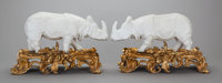 A PAIR OF BISQUE PORCELAIN FIGURES OF RHINOCEROS ON LOUIS XV-STYLE GILT BRONZE BASES, 20th century 8-1/2 x 13-3/4
