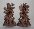 Sculpture, A PAIR OF BLACK FOREST CARVED WOOD CANDLE HOLDERS, 20th century. 13-3/4 inches high (34.9 cm). ... (Total: 2 Items)