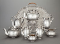 AN EIGHT PIECE AUSTRIAN SILVER TEA AND COFFEE SERVICE WITH AN ASSOCIATED ENGLISH SILVER HOT WATER KETTLE AND STAND, J