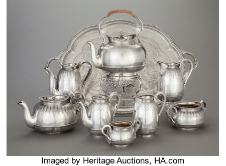 AN EIGHT PIECE AUSTRIAN SILVER TEA AND COFFEE SERVICE WITH AN ASSOCIATED ENGLISH SILVER HOT WATER KETTLE AND STAND, Joseph C... (Total: 9 Items)