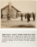 "Photography:Official Photos, Annie Oakley: A Mammoth 14"" x 11"" Underwood & Underwood Glossy Photo Showing Her Shooting an Orange from the Head of her Dog ""..."