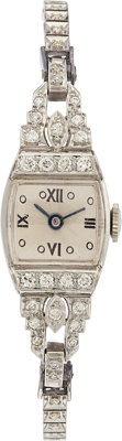 SWISS LADY'S DIAMOND, PLATINUM, WHITE GOLD WRISTWATCH