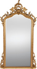 Decorative Arts, French:Other , A FRENCH CARVED GILT WOOD MIRROR, circa 1900. 67 inches high x 37inches wide (170.2 x 94.0 cm). ...