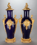 Decorative Arts, French:Other , A PAIR OF MONUMENTAL COBALT BLUE PORCELAIN AND GILT BRONZE MOUNTEDCOVERED URNS, circa 1900. 48 x 20 x 15 inches (121.9 x 50...(Total: 2 Items)