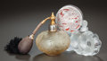 Art Glass:Lalique, TWO LALIQUE GLASS PERFUME BOTTLES AND A LALIQUE FLEURSD'AMOUR POWDER BOX, 20th century. Marks to floral bottle:...(Total: 3 Items)