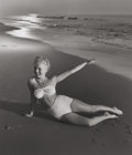 Photographs, ANDRE DE DIENES (American, 1913-1985). Marilyn at Tobey Beach, 1949. Vintage gelatin silver. 12-1/4 x 10-1/2 inches (31....