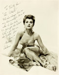 "Autographs:Celebrities, Debra Paget (b. 1933, American actress) Photograph Signed. Measures11"" x 14"". Some minor wrinkling and edgewear. Very good...."