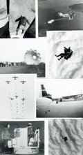 """Books:Prints & Leaves, Group of Eight Photographs Depicting Military Parachuting in WorldWar I and II. Each measures 8"""" x 11"""". Notes and inkstamps..."""