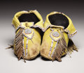 American Indian Art:Beadwork, A PAIR OF COMANCHE BEADED HIDE MOCCASINS. . c.1880. ... (Total: 2Items)