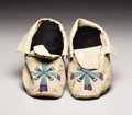 American Indian Art:Beadwork, A PAIR OF SIOUX BEADED HIDE MOCCASINS. . c. 1900. ... (Total: 2Items)