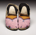 Other, A PAIR OF SIOUX BEADED HIDE MOCCASINS. . c. 1890. ... (Total: 2 Items)