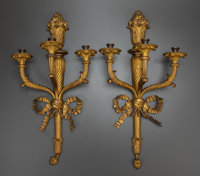 A PAIR OF EMPIRE-STYLE GILT BRONZE THREE-LIGHT WALL SCONCES, 19th century 28 inches high x 15 inches wide (71.1 x