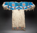 American Indian Art:Beadwork and Quillwork, A SIOUX BEADED HIDE DRESS. c. 1900 ...