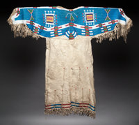 A SIOUX BEADED HIDE DRESS c. 1900