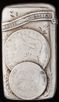 AN AMERICAN SILVER AND COIN SILVER MATCH SAFE, circa 1889 3 inches high (7.6 cm) 3.37 troy ounces  FROM T
