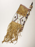American Indian Art:Beadwork, A UTE BEADED BUFFALO HIDE TOBACCO BAG. . c. 1870. ...