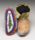 American Indian Art:Beadwork, A PAIR OF SIOUX CHILD'S QUILLED AND BEADED HIDE CEREMONIALMOCCASINS. c. 1890. ... (Total: 2 Items)