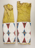 American Indian Art:Beadwork, A PAIR OF CHEYENNE WOMAN'S BEADED HIDE LEGGINGS. c. 1890. ...(Total: 2 Pieces)