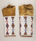 American Indian Art:Beadwork, A PAIR OF CHEYENNE GIRL'S BEADED HIDE LEGGINGS. c. 1890. ...(Total: 2 Pieces)
