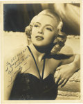 "Movie/TV Memorabilia:Autographs and Signed Items, Lana Turner Signed Photo. A b&w 8"" x 10"" photo of the legendarymovie star, inscribed and signed by her in black ink. In Fin...(Total: 1 Item)"