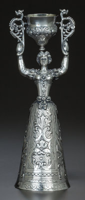 A GERMAN SILVER AND SILVER GILT FIGURAL WAGER CUP, Friedrich Reusswig, Hanau, Germany, 19th century Marks: (fle