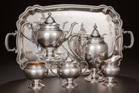 A FIVE PIECE AMERICAN SILVER AND SILVER GILT TEA & COFFEE SERVICE AND ASSOCIATED PERUVIAN SILVER TRAY, Gorham Ma...