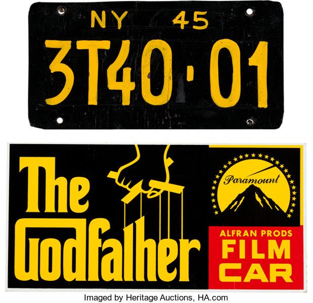 A Prop License Plate and Dashboard Display Card from