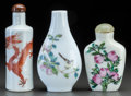 Asian:Japanese, THREE CHINESE PORCELAIN SNUFF BOTTLES. Marks: (chop marks). 3-1/4inches high (8.3 cm) (dragon bottle). ... (Total: 3 Items)