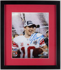 Football Collectibles:Photos, Eli Manning Signed Photograph....