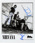 Music Memorabilia:Autographs and Signed Items, Nirvana Group-Signed Geffen Promo Photo. ...