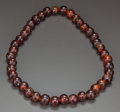 Asian:Chinese, A CHINESE AMBER STRING OF BEADS, 19th century. 29-1/4 inchesdiameter (74.3 cm). ...