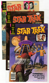 Star Trek #44, 53, and 57 Group (Gold Key, 1977-78) Condition: Average VF/NM. Painted covers on all three issues in this...