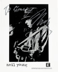 Music Memorabilia:Autographs and Signed Items, Neil Young Signed Black and White Publicity Photograph (c.1994)....