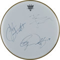 Music Memorabilia:Autographs and Signed Items, The Who Band-Signed (by Three) Remo Drum Head. ...