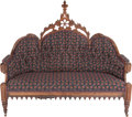 Furniture , A VICTORIAN GOTHIC REVIVAL UPHOLSTERED OAK SETTEE, circa 1865. 53-1/4 x 61 x 22 inches (135.3 x 154.9 x 55.9 cm). ...